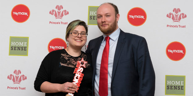 Two young people holding a Prince's Trust Award