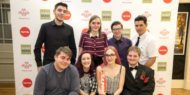 A group of young people in a group photo holding a Prince's Trust Award