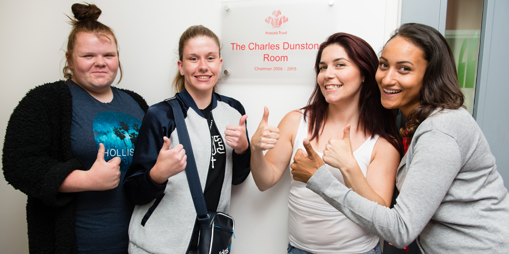 Prince's Trust programme staff standing outside The Charles Dunstone Room in Poplar centre