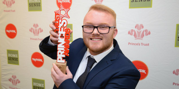 Young person holding a Prince's Trust Award