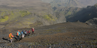 Group of people trekking through Iceland