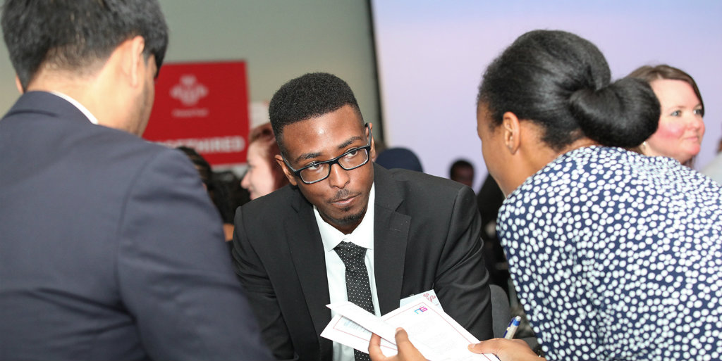 Young person talking to interviewers