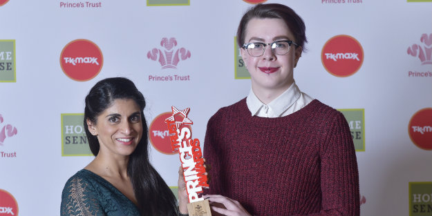 Young person standing next to a lady holding a Prince's Trust Award