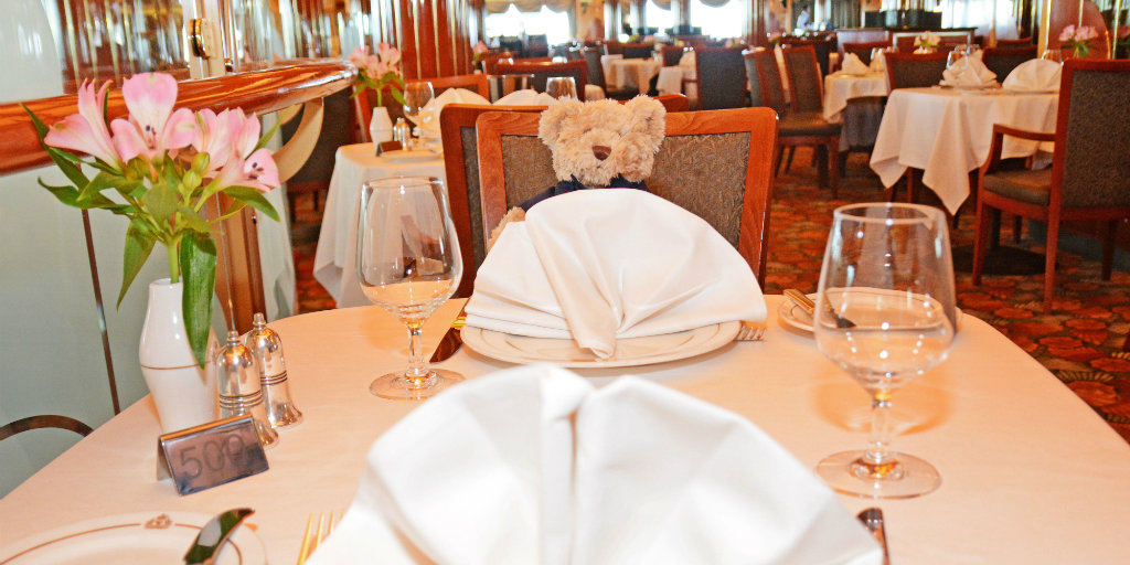 Charles the bear sitting at the dinner table
