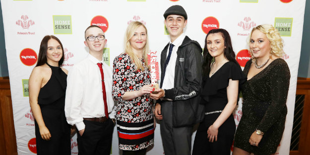 A group of young people standing next to each other holding a Prince's Trust Award