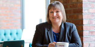 New Prince's Trust Trustee Alison Brittain holding Costa Coffee cup