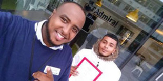 Youth worker Ali Abdi with young person David Singh