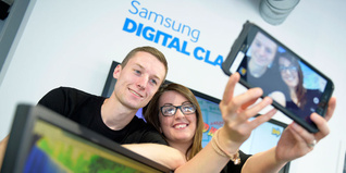 Young people try out the technology in the new Samsung Digital Classroom