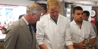 HRH The Prince of Wales meets young people Sam and Fred at Looe fish market