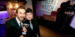 Nathan Thomas (right) receiving his award from comedian, Patrick Monahan (left)