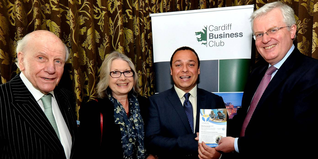 Daniel Williams receiving his award from Cardiff Business Club