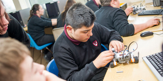 Young people working on robotics projects