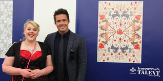 Sally Derby poses for a photo with Spencer Matthews and her winning design