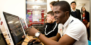Young people learning digital skills in the Digital Classroom sponsored by Samsung at our Kennington Centre in London.