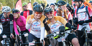 Two gold jersey cyclists at the start line of Palace to Palace