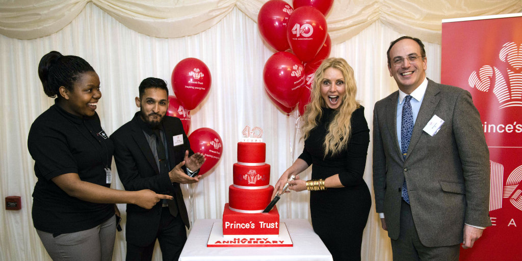 MP Michael Ellis, Carol Vorderman and Young Ambassadors cutting cake