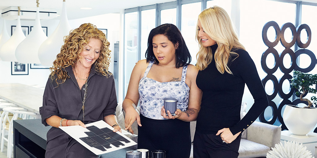 Kelly Hoppen, Jaidah Thomas and Tess Daly with Trust candle