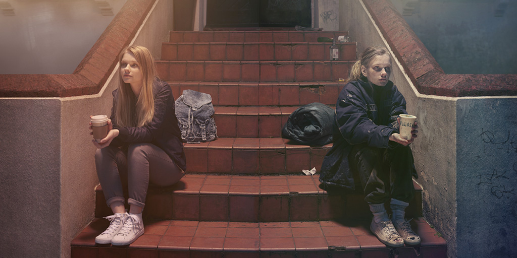 Two girls sat on steps