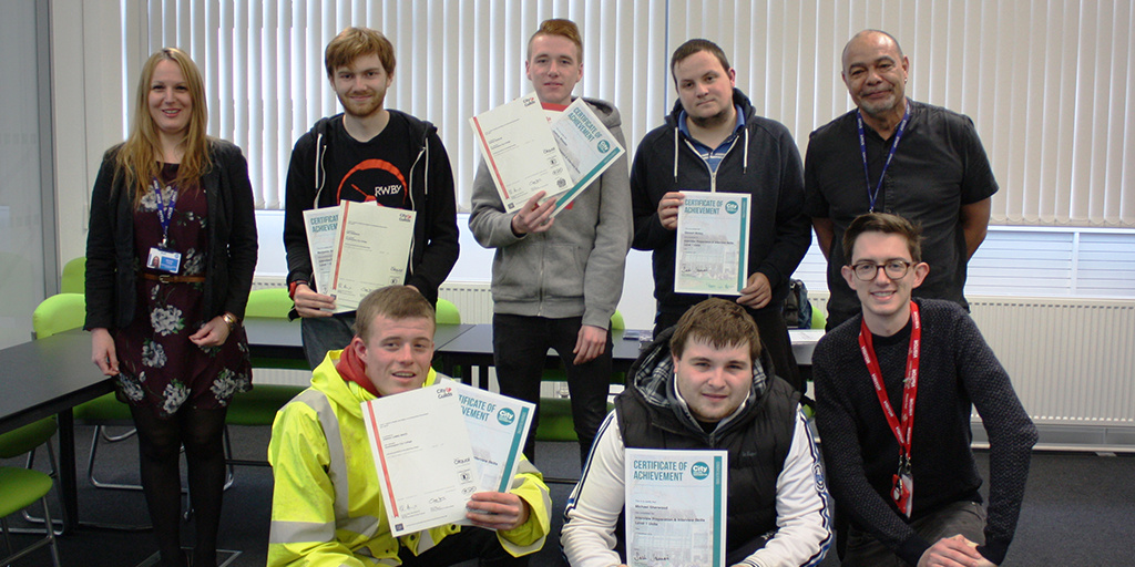 Young people with certificates after completing a Get into course