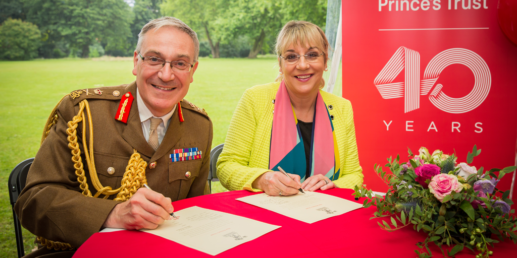 General Nugee, Chief Defence of People (CDP) for the Ministry of Defence and Martina Milburn CBE sign the Armed Forces Covenant