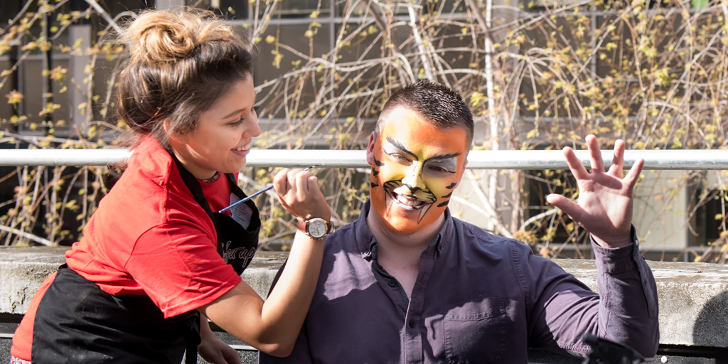 Face-painting a tiger design
