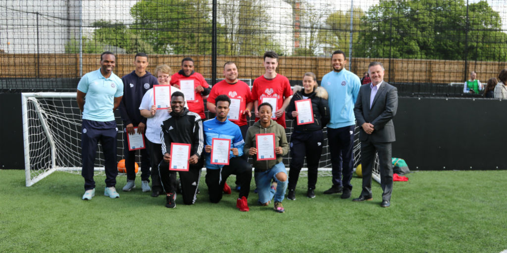 Group of young people attending a Prince's Trust Get Started with Football celebration event at QPR F.C.