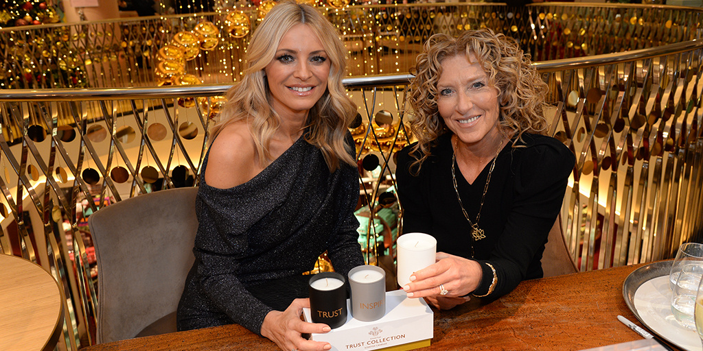 Both Kelly Hoppen and Tess Daly are sitting next to each smiling.