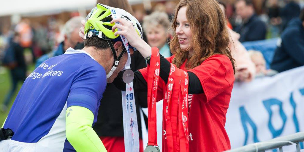 Palace cyclist receiving his medal